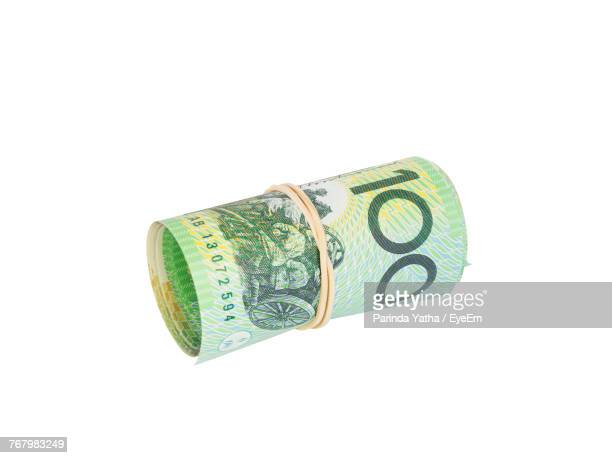 Close-Up Of Paper Currency Over White Background