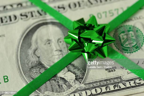 close-up of paper currency with ribbon - christmas cash stock pictures, royalty-free photos & images
