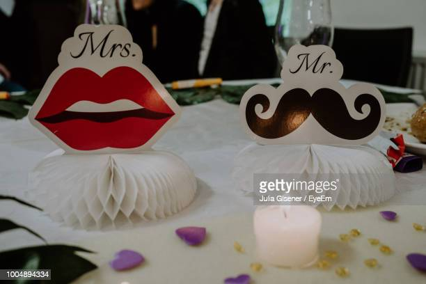 Close-Up Of Paper Decor By Candle On Table