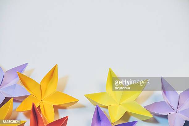 Close-Up Of Paper Flower Against White Background