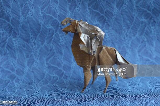 close-up of paper horse on blue backdrop - animal representation stock pictures, royalty-free photos & images