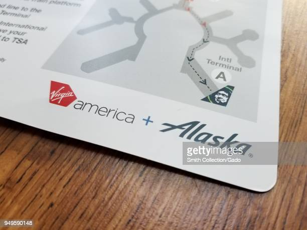 Virgin airlines group pictures and photos getty images closeup of paper showing logos of alaska airlines and virgin america in advance of the merger reheart Choice Image