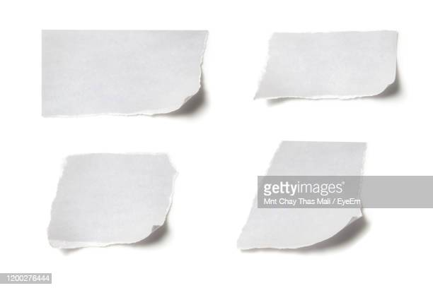 close-up of papers over white background - torn stock pictures, royalty-free photos & images