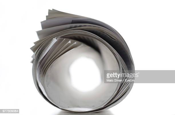 close-up of papers over white background - rolled up stock pictures, royalty-free photos & images