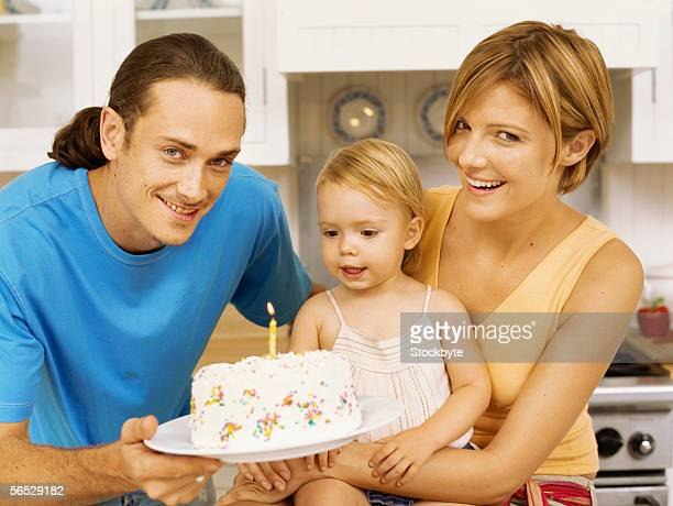 close-up of parents celebrating their daughter's birthday