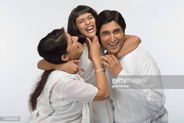 Close-up of parents having fun with their daughter