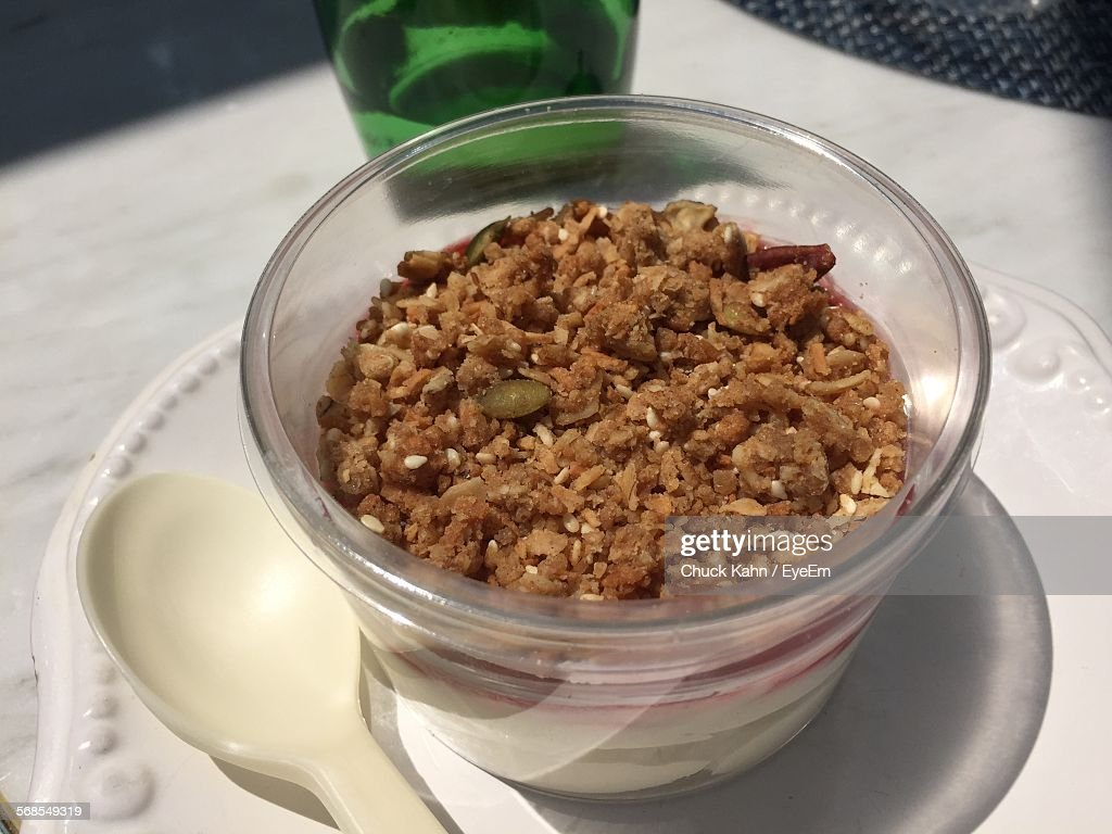 Close-Up Of Parfait And Spoon In Plate : Stock Photo