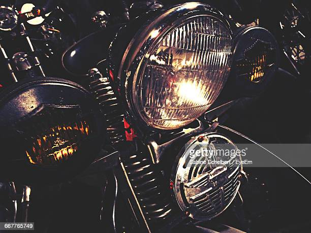 Close-Up Of Parked Motorcycle Headlight