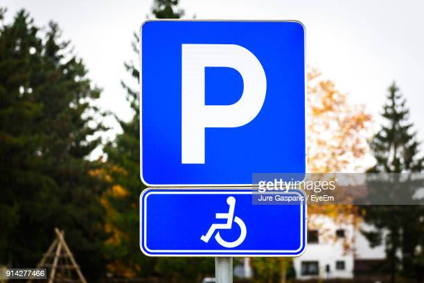 close-up of parking sign for disable - parking sign stock photos and pictures