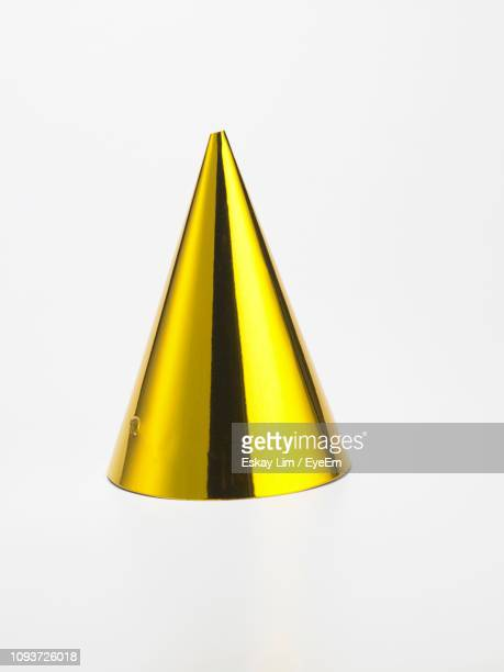 close-up of party hat on white background - cone shaped objects stock pictures, royalty-free photos & images