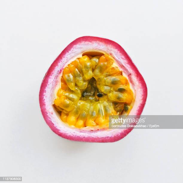 close-up of passion fruit against white background - tropical fruit stock pictures, royalty-free photos & images
