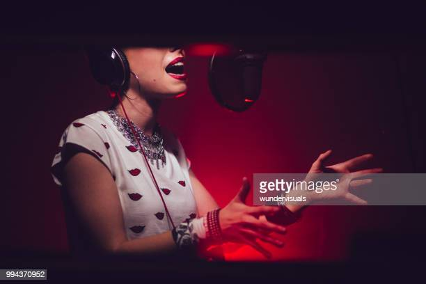 close-up of passionate singer recording song in music studio - pop music stock pictures, royalty-free photos & images