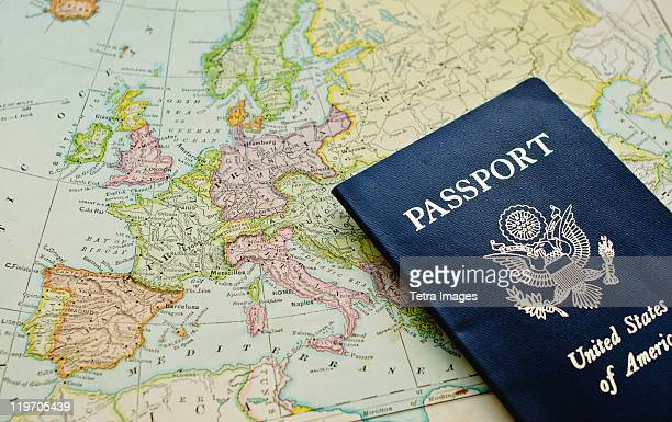 close-up of passport lying on european map - passeport photos et images de collection