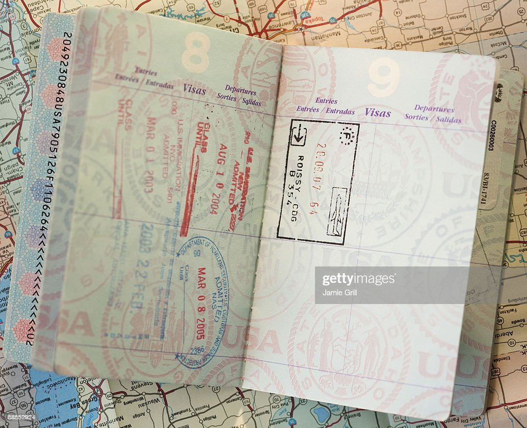 Close-up of passport on map : Stock Photo