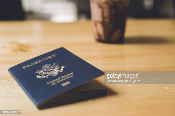 close-up of passport on table - passeport photos et images de collection