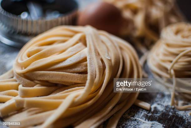 close-up of pasta on table - pasta stock pictures, royalty-free photos & images