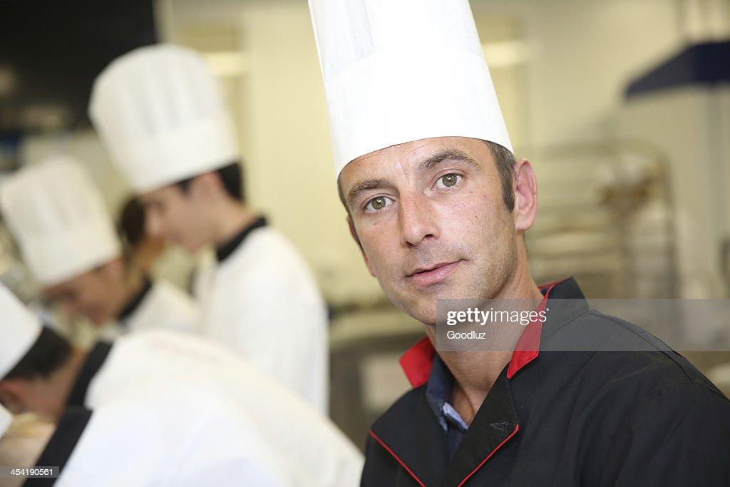 Closeup of pastry chef looking at camera : Stock Photo