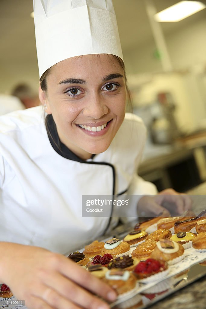 Closeup of pastry cook with succulent pastries : Stock Photo