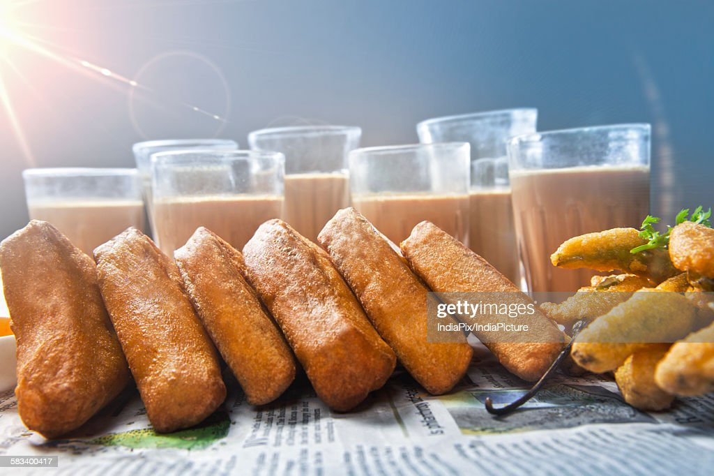 Close-up of pastry crust and chai for breakfast, DELHI, INDIA : Stock Photo