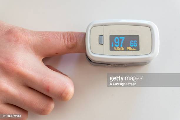 close-up of patient using pulse oxymeter - pulse oximeter stock pictures, royalty-free photos & images