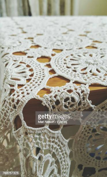 Close-Up Of Patterned White Tablecloth