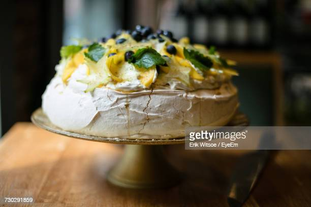 close-up of pavlova cake on table - meringue stock pictures, royalty-free photos & images