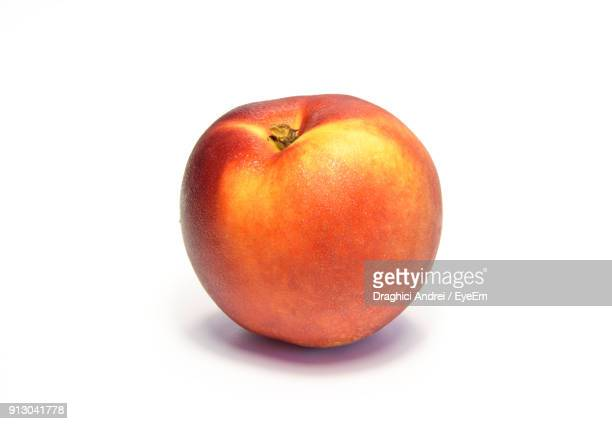 Close-Up Of Peach Against White Background