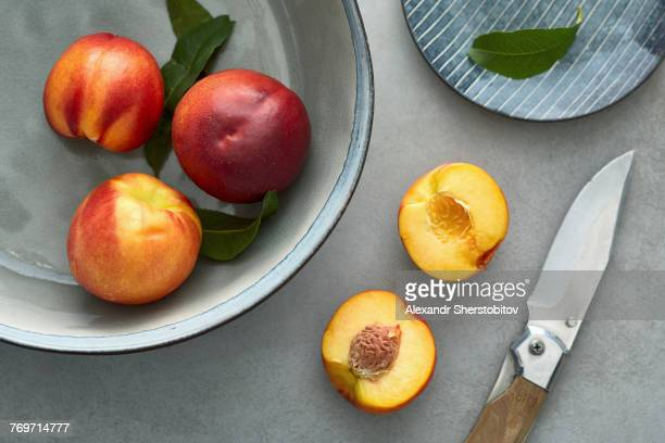 Close-up of peaches on table and container
