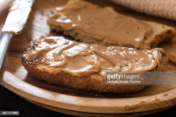 close-up of peanut butter on bread - peanut butter stock pictures, royalty-free photos & images