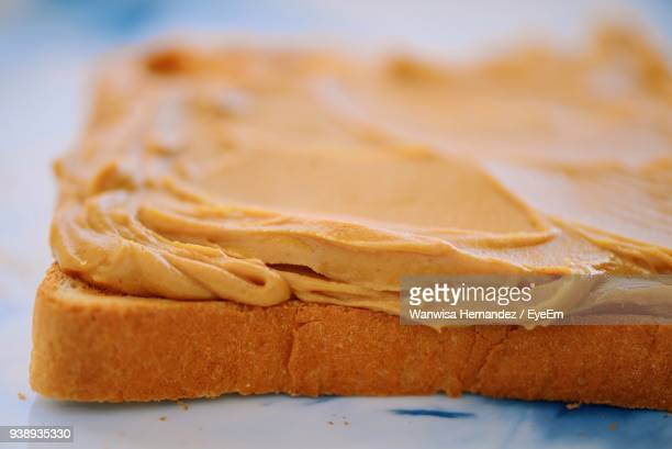 close-up of peanut butter on bread slice - peanut butter stock pictures, royalty-free photos & images