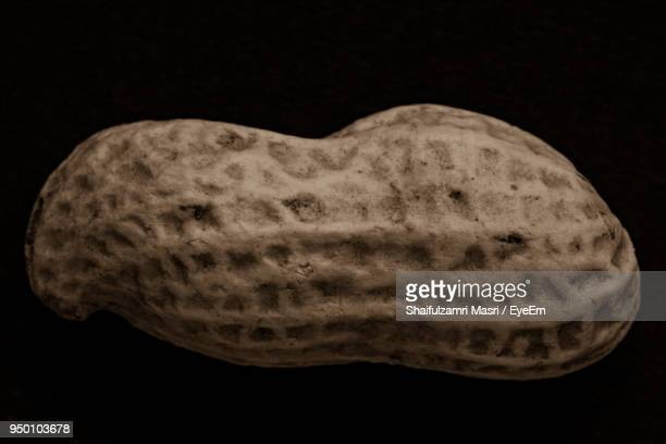 Close-Up Of Peanut Over Black Background