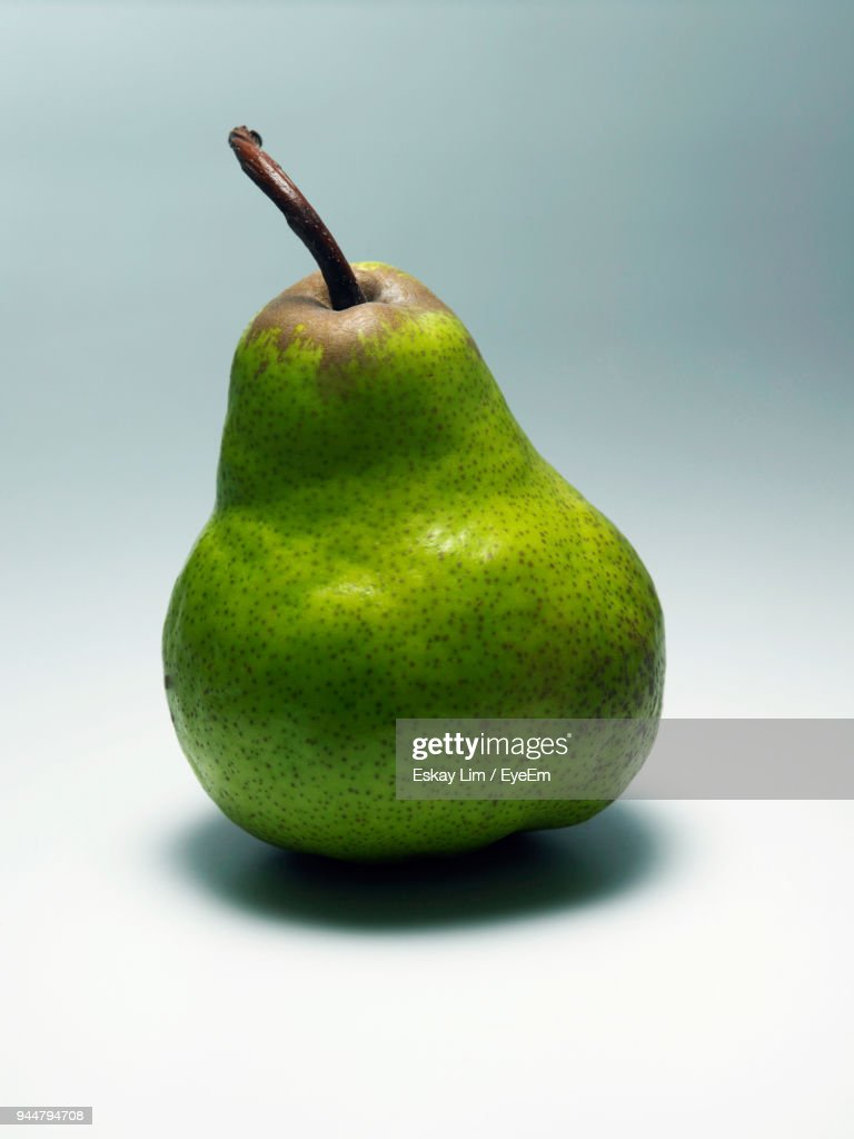 Close-Up Of Pear Against Gray Background : Stock Photo
