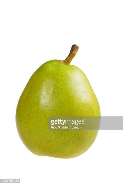 close-up of pear against white background - pear stock pictures, royalty-free photos & images