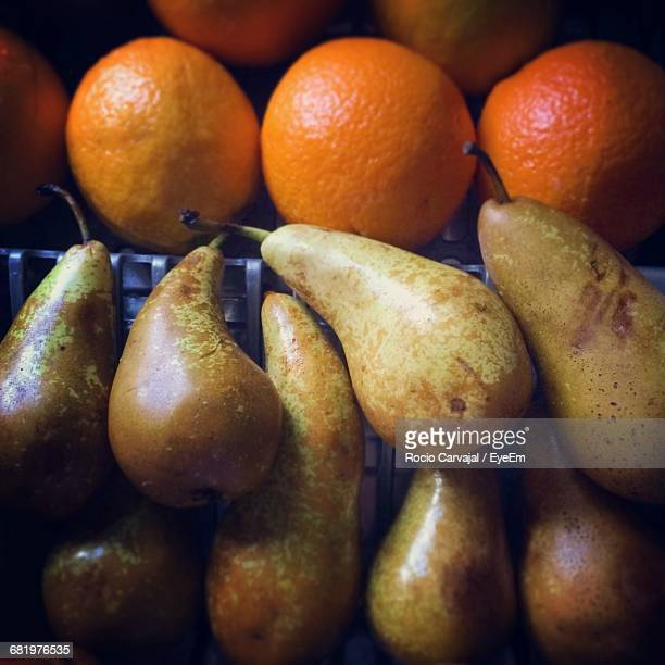close-up of pear and oranges - carvajal stock photos and pictures