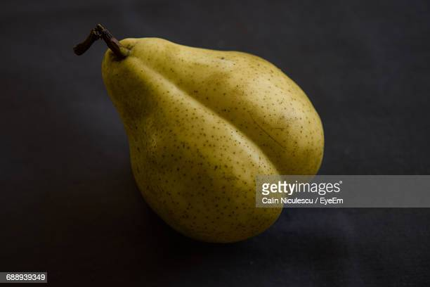 Close-Up Of Pear On Black Table