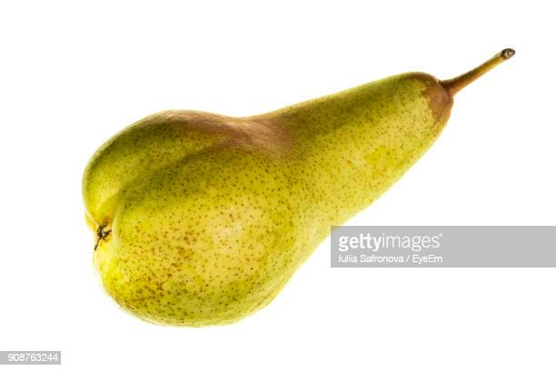 Close-Up Of Pear Over White Background