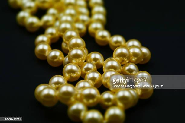 close-up of pearl necklace on black background - pearl jewellery stock pictures, royalty-free photos & images
