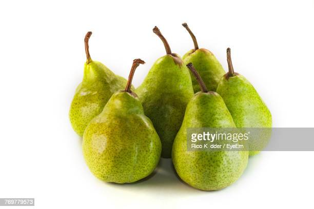 close-up of pears against white background - pear stock pictures, royalty-free photos & images