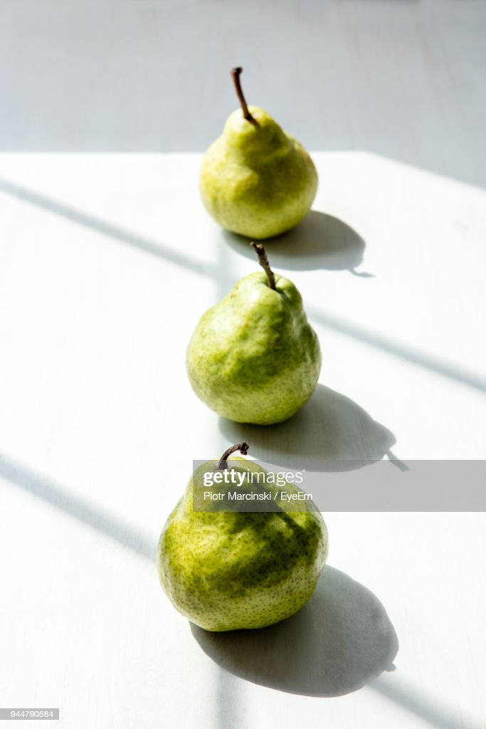 Close-Up Of Pears On Table : Stock Photo