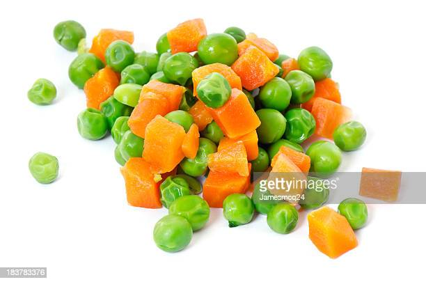 A close-up of peas and carrots