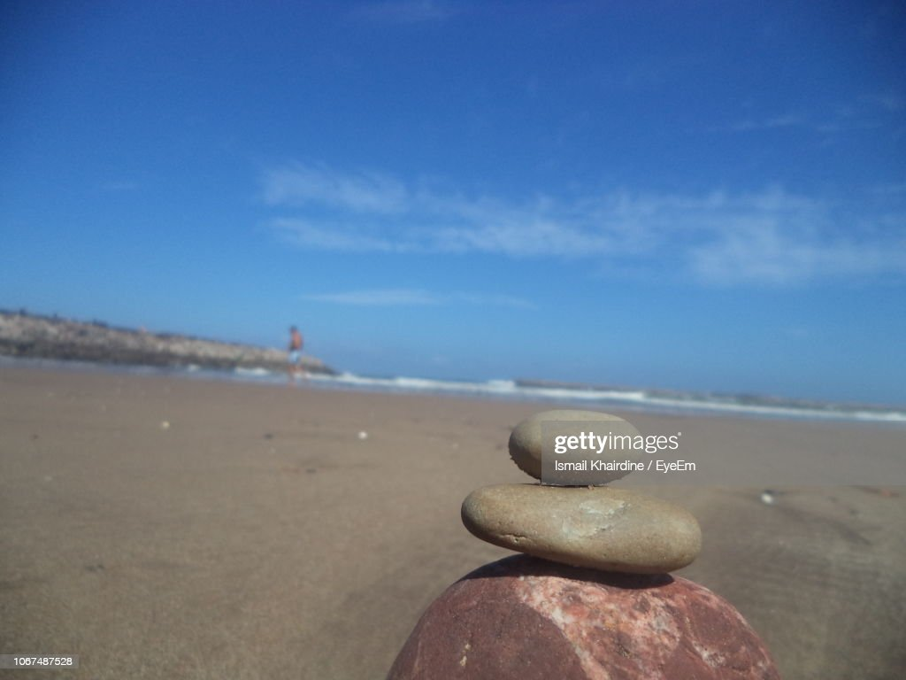 Close-Up Of Pebbles On Beach Against Sky : Stock Photo