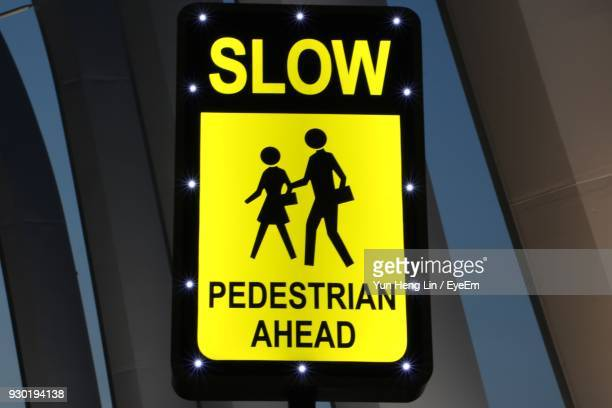 Close-Up Of Pedestrian Crossing Signboard