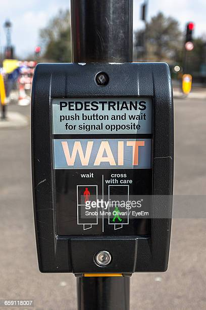 close-up of pedestrian sign on pole - pedestrian crossing sign stock photos and pictures