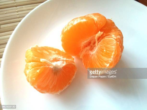 Close-Up Of Peeled Orange In Plate