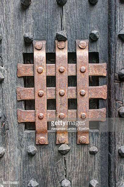 Close-Up Of Peephole On Old Wooden Door