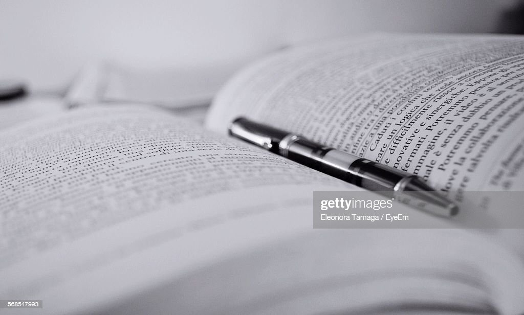 Close-Up Of Pen On Book : Stock Photo