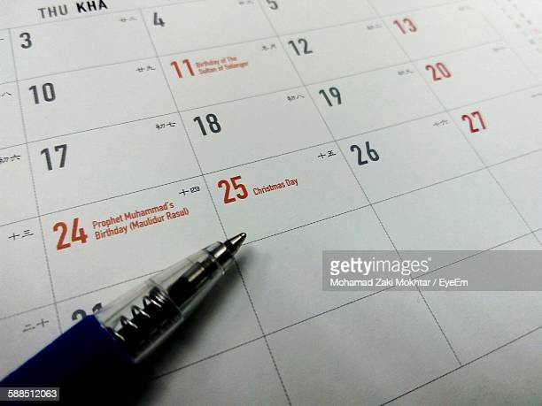 Close-Up Of Pen On Calendar Pointing At Christmas Date