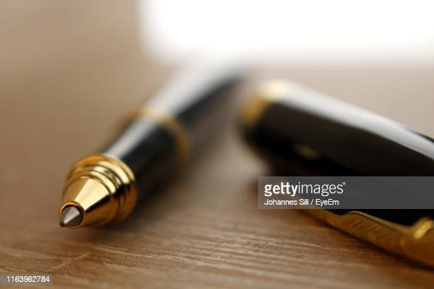 close-up of pen on table - ballpoint pen stock pictures, royalty-free photos & images