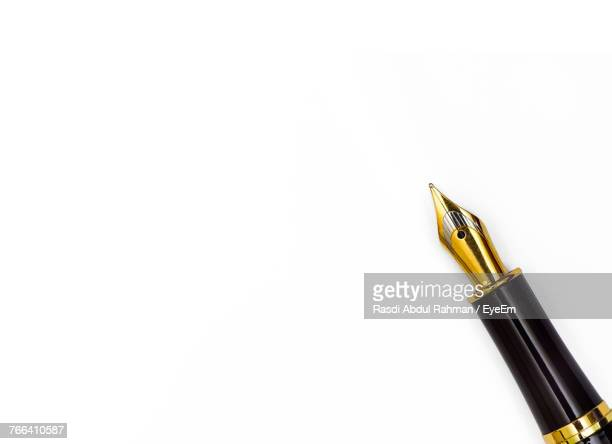 Close-Up Of Pen Over White Background