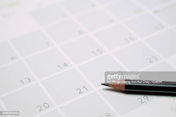 Close-Up Of Pencil On Calendar